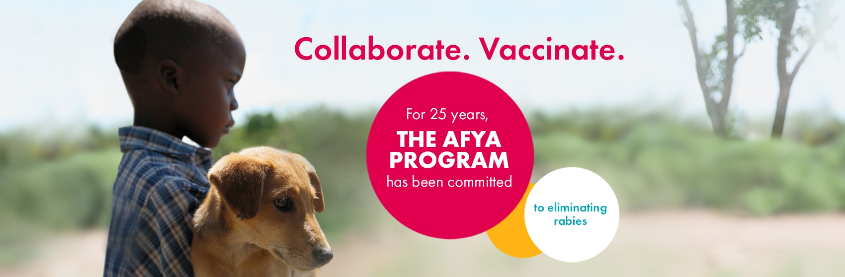 A boy and his dog in the Serengeti showing that for 25 years, The Afya Program has been committed to eliminating rabies.