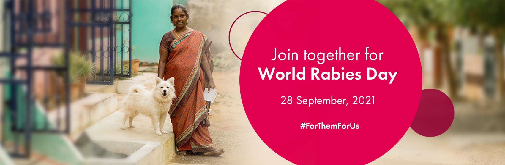 A woman stands with her dog to commemorate World Rabies Day.